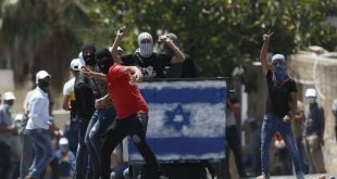 Palestinian demonstrators hurl stones at Israeli troops during a protest of Israel's plan to annex parts of the West Bank in village of Kufr Qaddumm on July 3, 2020. (AP Photo/Majdi Mohammed)