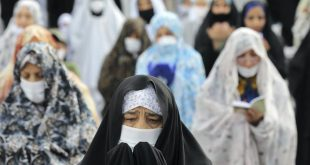 Worshippers wearing protective face masks and gloves offer Eid al-Fitr prayers in Teheran. AP Photo/Ebrahim Noroozi