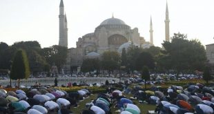 Muslims offer their prayers during the Eid al-Adha prayer, backdropped by Hagia Sophia, July 31, 2020. Some believe the building stands on an ancient pagan site. (AP Photo/Yasin Akgul)