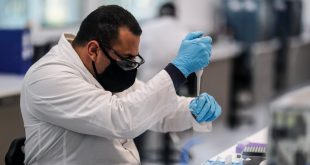 A researcher working on the University of Oxford/AstraZeneca vaccine in Buenos Aires. EPA-EFE