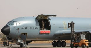 French Air Force soldiers work on a Boeing C135 parked on the French Air Force base in Niamey, Niger in December, 2017.