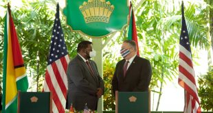 Secretary of State Mike Pompeo with Guyana's president, Mohamed Irfaan Ali, Sept. 18. Pompeo is the first U.S. secretary of state to visit the tiny South American country. AFP via Getty Images