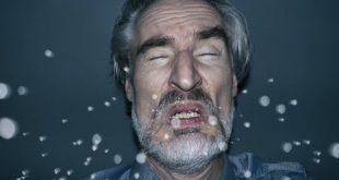 When a person sneezes, tiny droplets, or aerosols, can linger in the air. Jorg Greuel via Getty Images