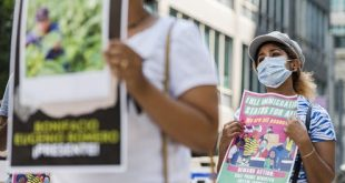 Protesters attend a demonstration in support of migrant worker in front of the Immigration and Refugee Board of Canada in Toronto in August 2020. THE CANADIAN PRESS/Christopher Katsarov