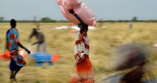 Villagers collect World Food Programme aid dropped from a plane Feb. 6 in South Sudan. Tony Karumba/AFP via Getty Images